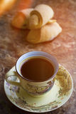 Hot black coffee with pastry Stock Photography