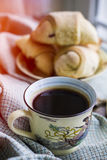 Hot black coffee with pastry Royalty Free Stock Photos