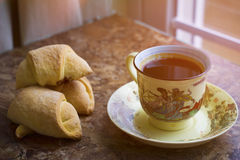 Hot black coffee with pastry Royalty Free Stock Images