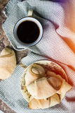 Hot black coffee with pastry Stock Images