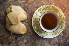 Hot black coffee with pastry Stock Image