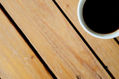 Hot black coffee on rough table and have some space for write wording Stock Images