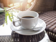 Hot black coffee in white ceramic cup Stock Photography