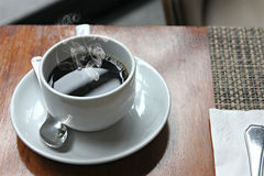 Hot Black coffee in a white cup. Royalty Free Stock Photography