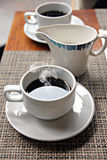 Hot Black coffee in a white cup. Royalty Free Stock Image