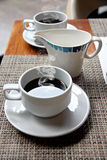 Hot Black coffee in a white cup. Royalty Free Stock Photo