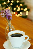 Hot black coffee on wooden table Royalty Free Stock Photos