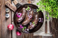 Hot black pudding with onion and parsley Royalty Free Stock Photo