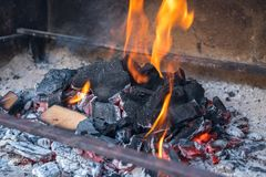 Hot black and red coals for barbecue, fire.  Royalty Free Stock Photo