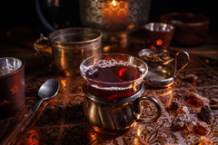 Hot black tea with candle Stock Photography