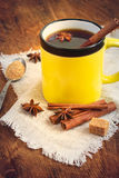 Hot black tea with cinnamon in a ceramic mug. Tinted. Royalty Free Stock Image