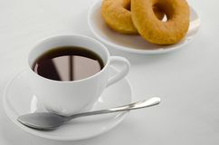 Tea and Donut for Relaxing Time. Hot black tea and donuts are easy appetizer for eating on the time of relax Stock Photo