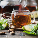 Hot black tea with lemon and mint on the wooden table Royalty Free Stock Photography