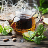 Hot black tea with lemon and mint on the wooden table Royalty Free Stock Photo