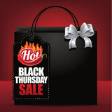 Hot Black Thursday sale tag and shopping bag background Royalty Free Stock Photo