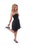 Hot blond model in a black transparent dress Stock Image