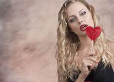 Hot blonde girl with red lollipop Stock Image