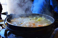 Hot boiling soup. Hot boiling vegetables soup in saucepan Stock Images