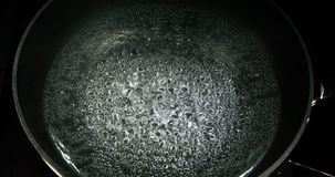 Hot boiling water in a saucepan, slow motion 4K