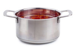Hot borsch in a steel pan isolated stock images