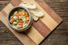 Bowl of chicken pesto chili soup and bread stock image