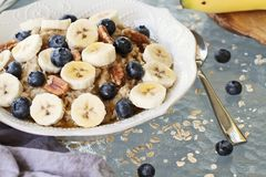 Hot Bowl of Oatmeal Bananas and Blueberries stock image