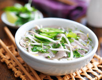 Hot bowl of pho with beef and rice noodles Stock Photo
