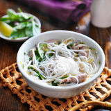 Hot bowl of pho with beef and rice noodles. Shot in square composition stock photos