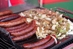 Hot Brats on the BBQ Grill Stock Images