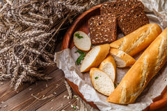 Hot bread in wooden bowl Royalty Free Stock Images