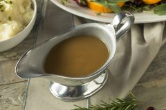 Hot Brown Organic Turkey Gravy. In a Boat Royalty Free Stock Photography