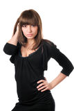 Hot brunette in black. Dress posing. Isolated on white Royalty Free Stock Photography