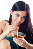 Hot brunette with cocktail Stock Images