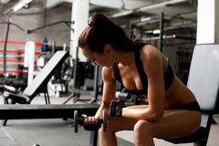 Hot brunette exercising in fitness center Royalty Free Stock Photography