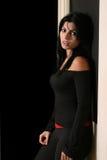 Hot brunette girl. Isolated on black background Royalty Free Stock Photo