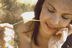 Hot brunette girl in the field Stock Images