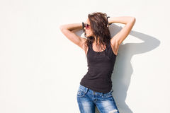 Hot brunette girl in hot sunlight. Stock Images