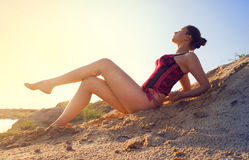 Hot brunette girl lying in the sun Stock Photo