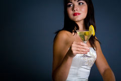 Hot brunette holding martini. Glass Royalty Free Stock Photo