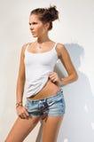 Hot brunette in hot summer sunshine. Stock Photography