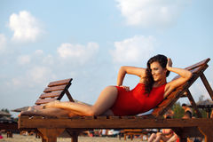 Hot brunette in red swimsuit Royalty Free Stock Images