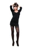 Hot brunette wearing black dress Stock Photos