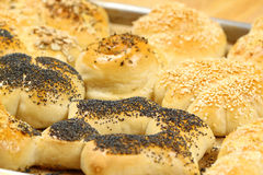 Hot buns. Hot home-made bread rolls sprinkled with seeds on tinplate Royalty Free Stock Images