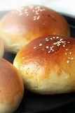 Hot buns. On black hot metal plate royalty free stock images