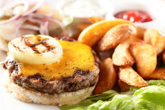 Hot burger with potato and salad Royalty Free Stock Image