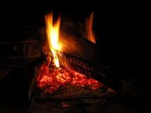 Hot burning fireplace Stock Photos