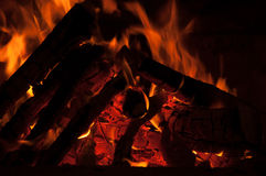 Hot Burning Logs on Fire. Burning logs with red hot embers and flames Stock Photography