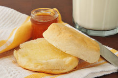 Hot buttered biscuit. Hot buttermilk biscuit with jam and a glass of milk Royalty Free Stock Photo