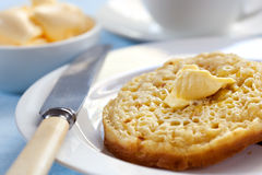 Hot buttered Crumpets. Hot buttered English crumpets.  Focus on melting butter Stock Images