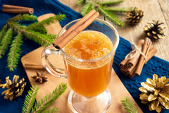 Hot buttered rum cocktail. With cinnamon for Christmas and winter holidays Stock Image
